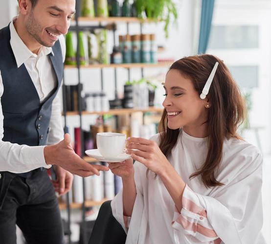 beautiful-woman-drinking-coffee-in-hair-salon-M4796UV.jpg
