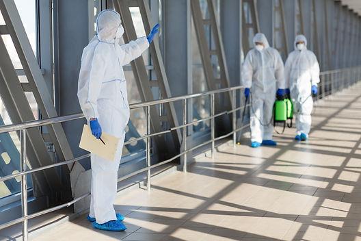 men-in-coronavirus-hazmats-prevention-co
