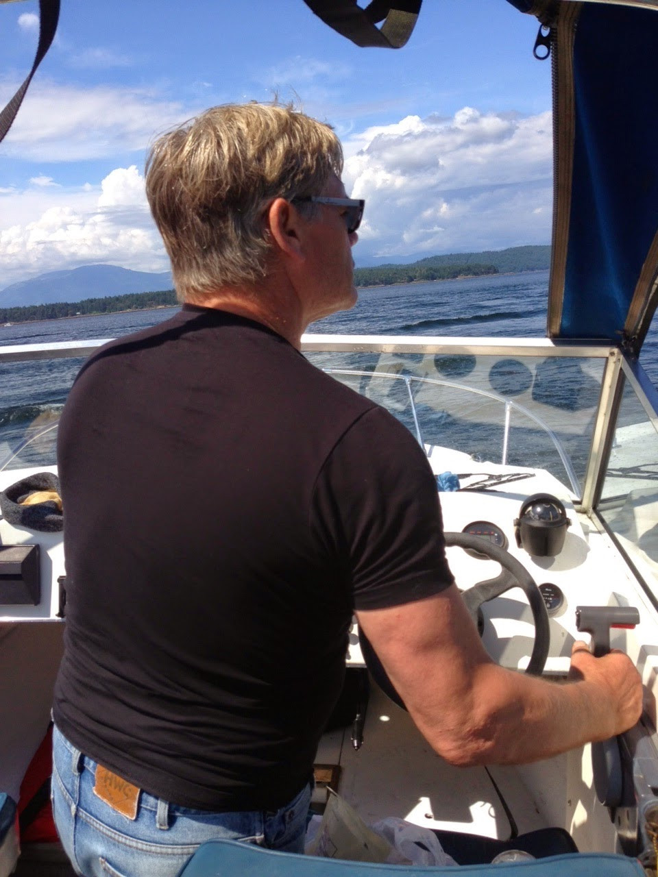Ryan driving the boat he received from the Canucks when he played his 100th NHL Game