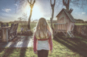 Back of Girl in a Yard