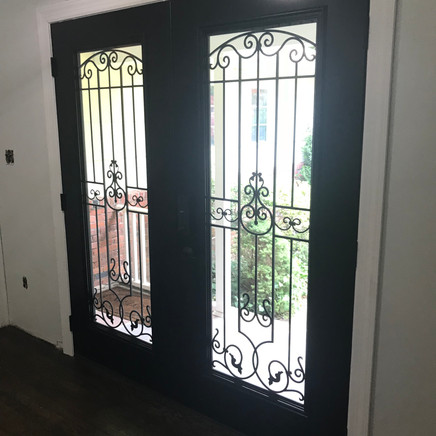 Double door with wrought iron installed