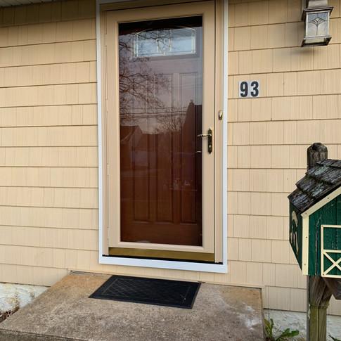 Front door with storm door installed