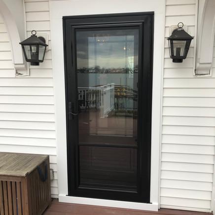 Black Entry Door with black storm door replacement