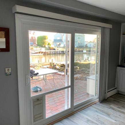 Patio door with doggy door installed