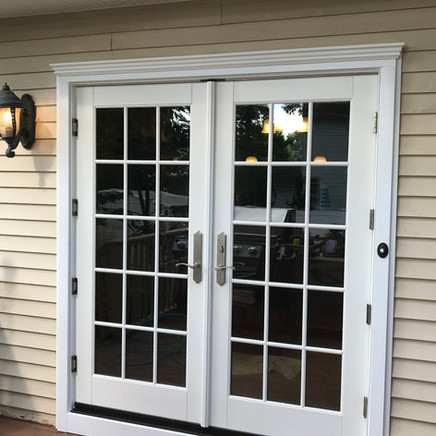 Outswing french door installed with Imperial Rake moulding