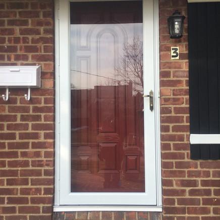 Red Front Door with white storm door