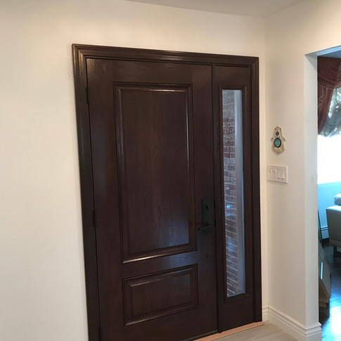 Mahoghany Front door with laminated sidelite installed