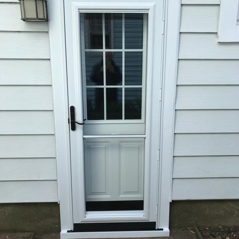 Back door with storm door installed