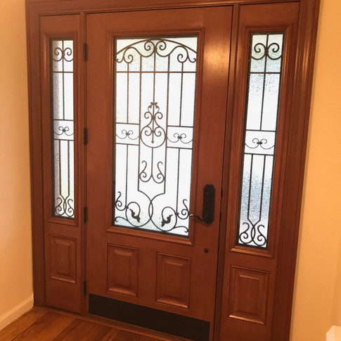 Embarq front door with sidelites and barcelona glass installed