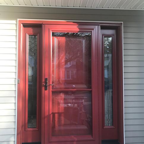 Front door with sidelites and storm door installed