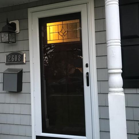 Front door and storm door installed