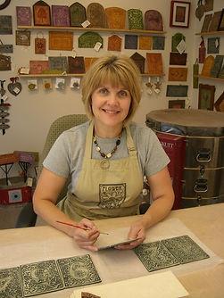 Louise Tessier painting ceramic tiles