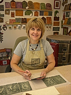 Louise Tessier painting ceramic tiles
