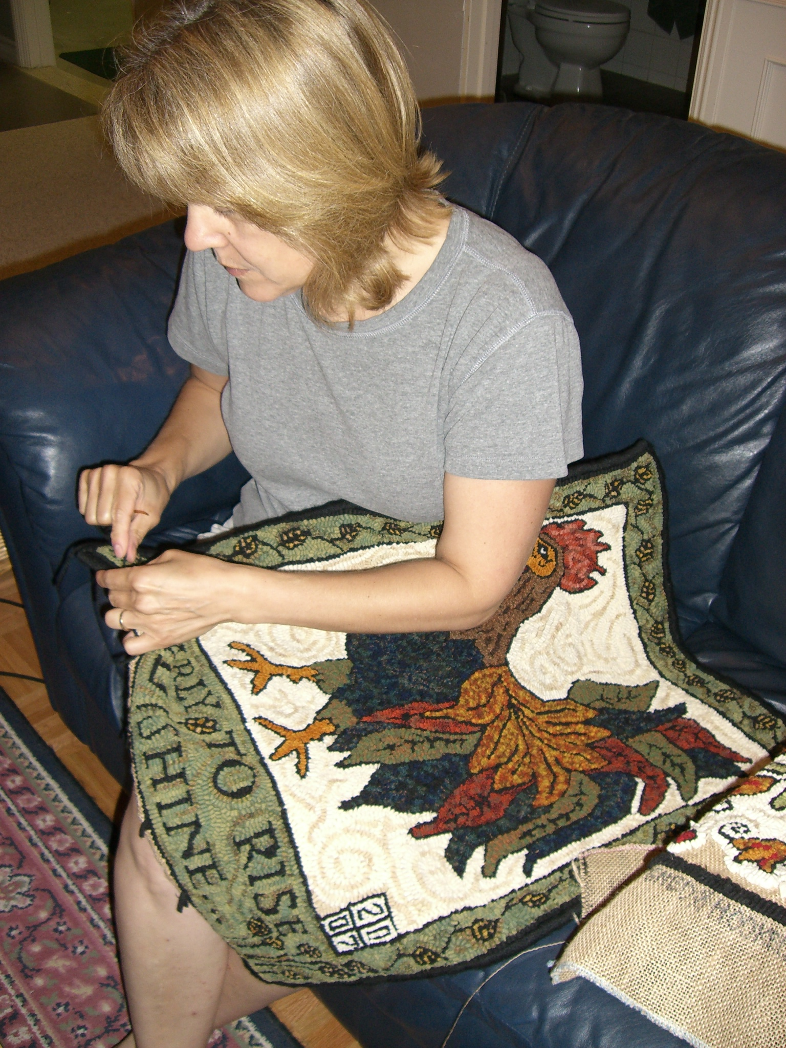 Finishing edges of my rooster rug!