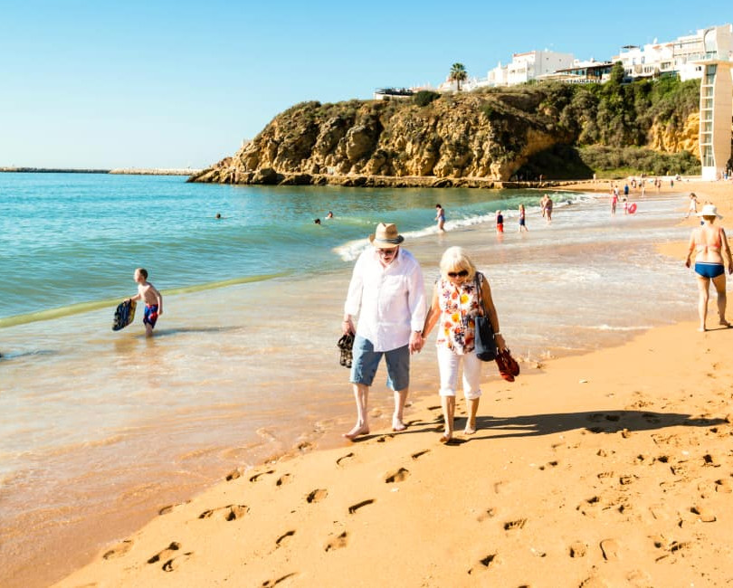 retired-couple-on-beach-Portugal.jpg