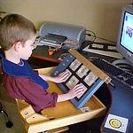 Evan_with_adapted_keyboard.jpg