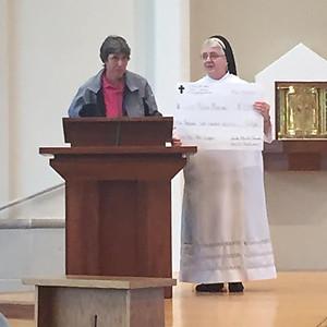Sr. Maria receiving Big Check