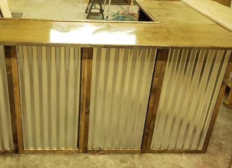 Corrugated metal inlays on exterior panels