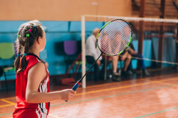 Badminton court with players
