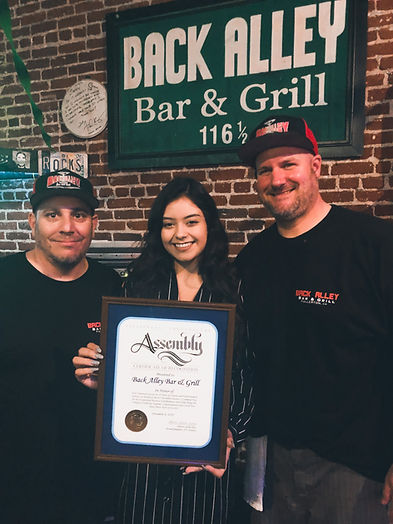 Back Alley Bar & Grill in Fullerton is recognized by California Legislature Assembly for being in business 20 years in Downtown Fullerton. Award was given December 2019. In picture is Chris Presta and Andrew McIntosh