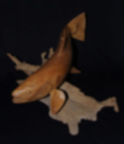 Handcrafted seatrout made from a single piece of elm.