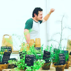 Paul from New Leaf Nurseries with a selection of his herbs in coir pots