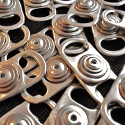 Ring-pulls from drink cans being recycled and repurposed