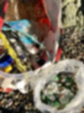 A typical beach collection; a bag of mainly plastic rubbish, and a bag of seaglass teasure.