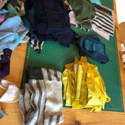 An assortment of quality garments ready to be upcycled