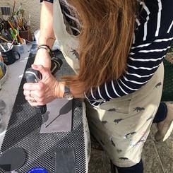 Lesley working on slate