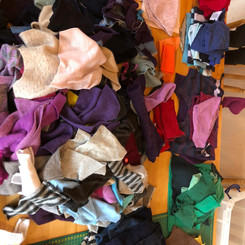 Quality cashmere garments waiting to be sorted, then upcycled