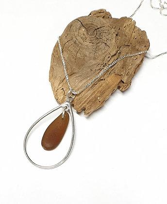 Nested seaglass in teardrop pendant