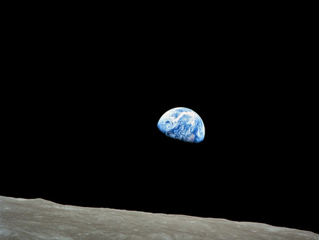 One Small Step: The Effect of Viewing Our Problems From Space