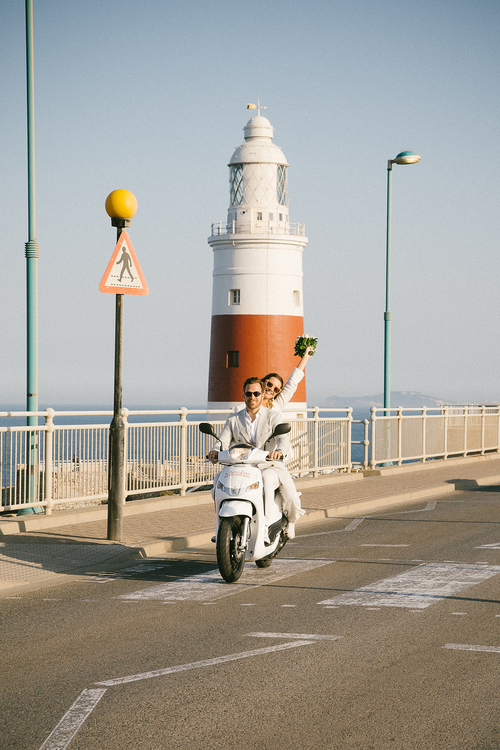 Cool Elopement couple on moped at Europa point Lighthouse