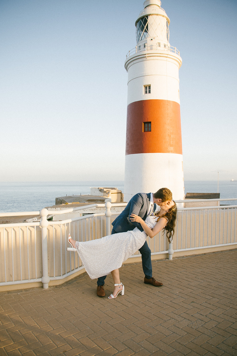 Couple kissing at europa point lighthouse