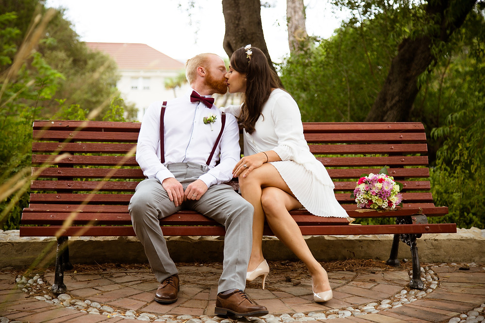 Couple in elegant outfits for their Gibraltar elopement