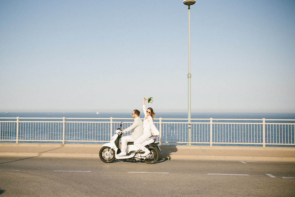 Elopement wedding photographer Gibraltar, Cool moped wedding photography, white wedding suits, John and Yoko style wedding, Sheila Roberts Photography