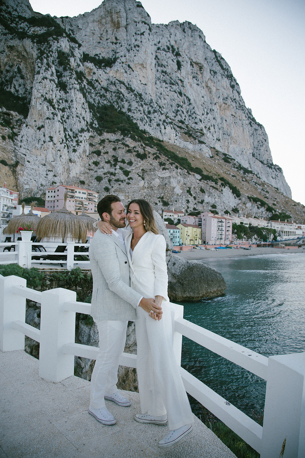 Catalan Bay Gibraltar Elopement wedding photography. Cool couple white suits.