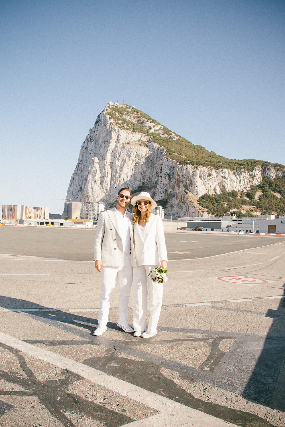 John and Yoko in Gibraltar style wedding outfits