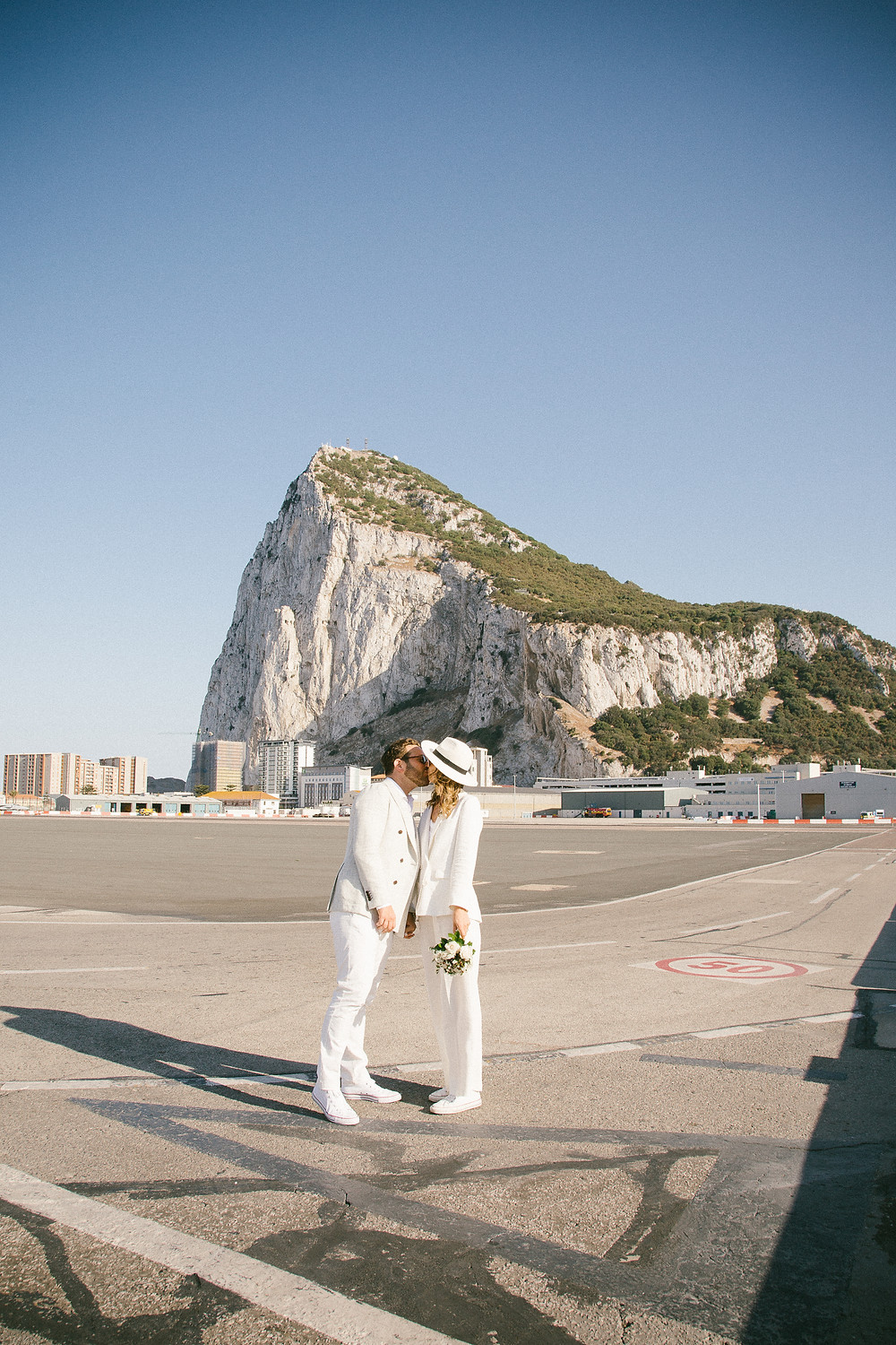 Cool couple Gibraltar elopement wedding John and Yoko style
