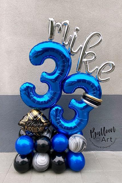 adult balloon birthday floor arrangment.