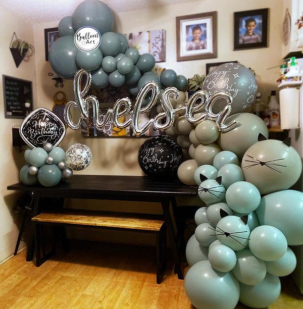 neutral green balloon garland