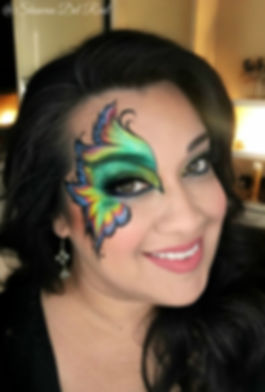 Butterfly bird face painting by Shawna