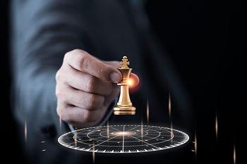 businessman-holding-throwing-golden-king