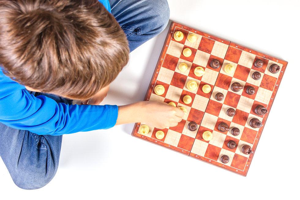 kid-playing-chess-game-chessboard.jpg