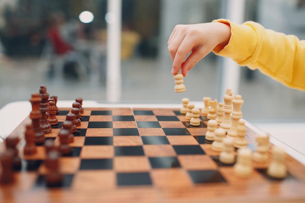 little-kids-playing-chess-kindergarten-e