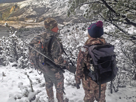 Hunting New Zealand Scott Wall and Myriam stalk after a fresh snowfall.jpg