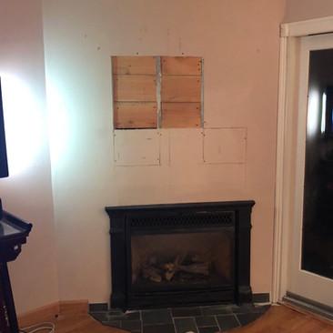 TV Mounted With Stone Backsplash (Before)