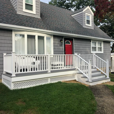 Resided House With Front Porch Built (After)