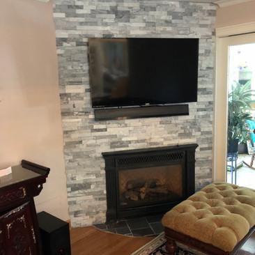 TV Mounted With Stone Backsplash (After)